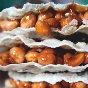 Bánh Cu Đơ. Whole peanut brittle between thin rice cakes